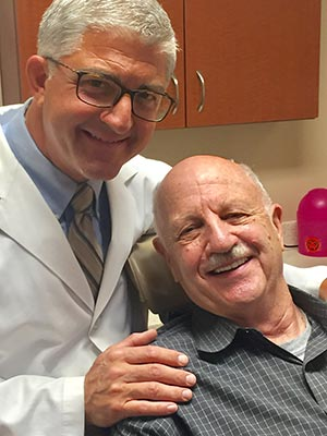 Dr.-Picchioni-with-patient.jpg